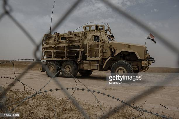 An Iraqi MineResistan Ambush Protected vehicle or MRAP along the frontline in Makhmour Iraqi on May 18 2016 Makhmour having been liberated from ISIS...
