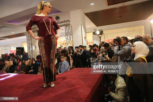 An Iraqi model presents a creation by an Iranian female fashion designer during a show at a shopping mall in the Iraqi capital Baghdad on January 17...