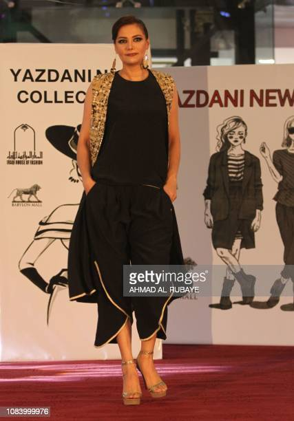 An Iraqi model presents a creation by two Iranian female fashion designers during a show at a shopping mall in the Iraqi capital Baghdad on January...