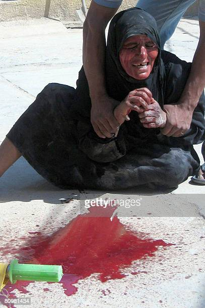 An Iraqi mother grieves and covers herself with the blood of her dead son who was a member of the Sahwa a Sunni antiQaeda group also known as the...
