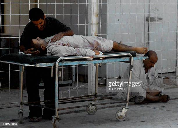 An Iraqi mourns over the body of his relative outside the morgue of a hospital at the restive city of Baquba north of Baghdad 12 September 2006 At...