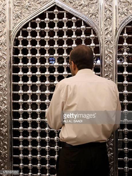 An Iraqi Muslim pilgrim prays at the shrine of the Sunni Sheikh Abdul Qadir alJilani in central Baghdad on June 7 2013 Attacks in Iraq have risen...