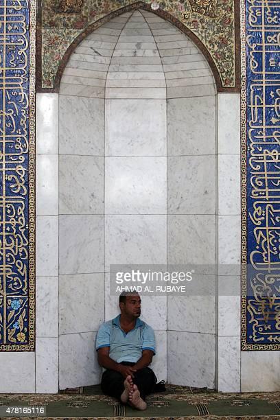 An Iraqi Muslim rests during Muslim holy month of Ramadan at the shrine of the Sunni Sheikh Abdul Qadir alJilani in central Baghdad on June 23 2015...