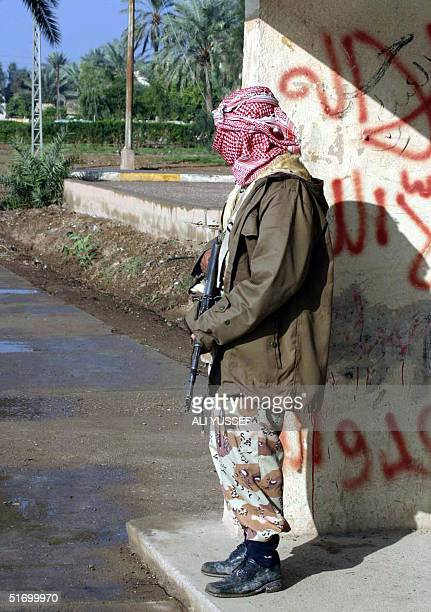 An Iraqi National Guard stands at the entrance of the hospital in the northeastern town of Baquba 60 kms from Baghdad 09 November 2004 At least 14...