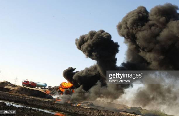 An Iraqi oil pipeline burns after sabotage by anti-US, pro-Saddam militants September 8, 2003 near Kirkuk, in northern Iraq. Sabotage and an average...