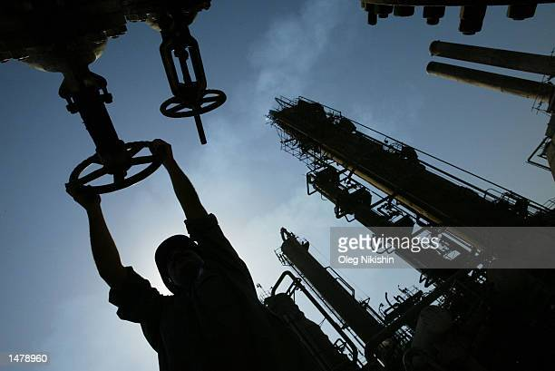An Iraqi oil worker works at AlDoura oil refinery October 14 2002 in Baghdad Iraq US President George W Bush signed a congressional resolution...