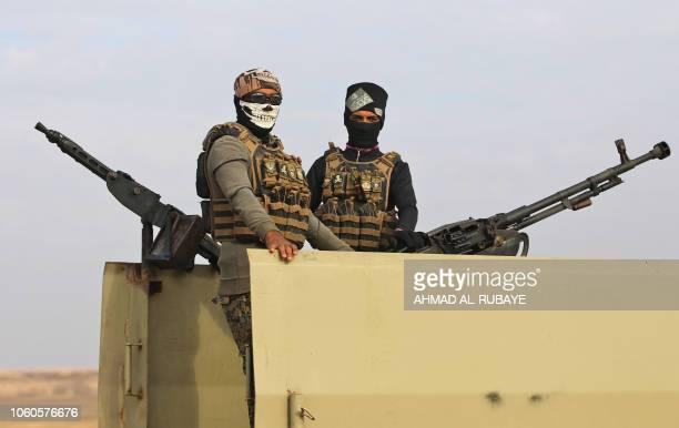 An Iraqi paramilitary unit from the Hashed alShaabi stands guard near the Iraqi city of Qaim at the IraqiSyrian border on November 11 2018 Iraqi...