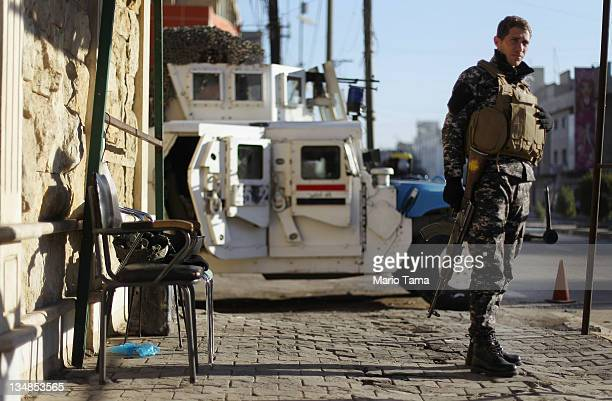 An Iraqi Police officer keeps watch outside Saint Mary of Rosary Catholic Church on December 4 2011 in Baghdad Iraq Forming one of the oldest...