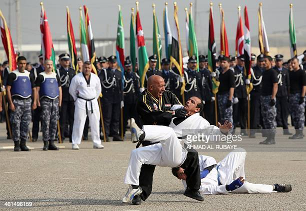 An Iraqi police officer shows his combat skills during a ceremony marking police forces 92nd anniversary in the capital Baghdad on January 9 2014 The...