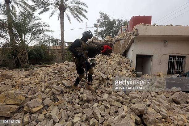 An Iraqi policeman checks the damage at a Sunni mosque that was destroyed during violence earlier in the month in the town of Muqdadiyah northeast of...