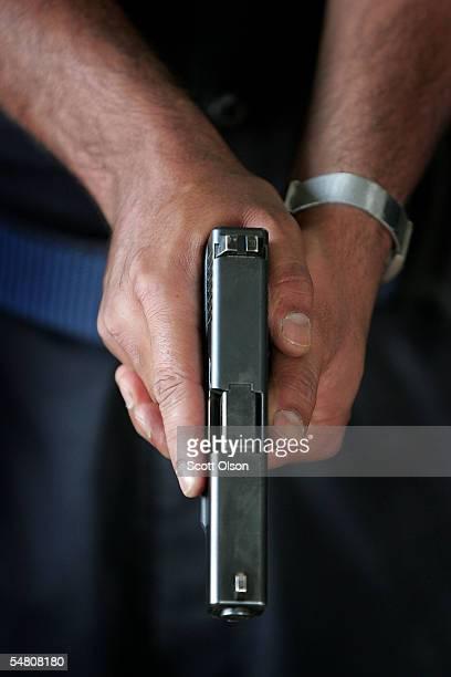 An Iraqi Policeman learns to shoot a 9mm pistol at the Jordan International Police Training Center September 3 2005 in Amman Jordan About 300...