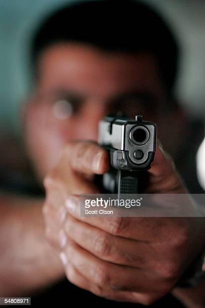An Iraqi Policeman learns to shoot a 9mm pistol at the Jordan International Police Training Center September 3 2005 in Amman Jordan About 300...