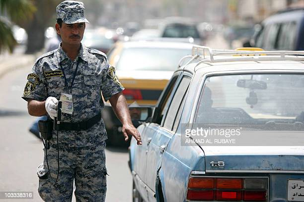 An Iraqi policeman mans a checkpoint in Baghdad on August 11 2010 as Iraqi forces impose tight security measures with the start of Islam's holy month...