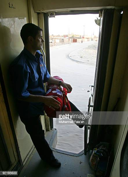An Iraqi policeman prepares to disembark from the Basra overnight train at Basra Railway Station on October 20 2009 in Basra Iraq As security...