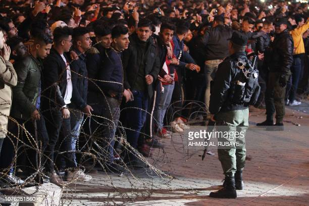 An Iraqi policeman stands guard as Iraqis celebrate the New Year January 1 2019 in Baghdad