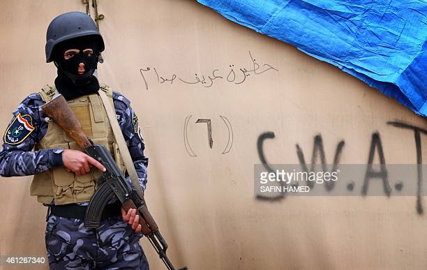 An Iraqi policeman stands guard at a training camp in the Bardarash district 30 kilometres northeast of Mosul on January 10 2015 as they prepare to...