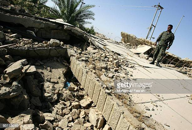 An Iraqi policeman stands over a house damaged in Falluja battle between the US military and insurgents in 2004 on November 12 2009 in the city of...