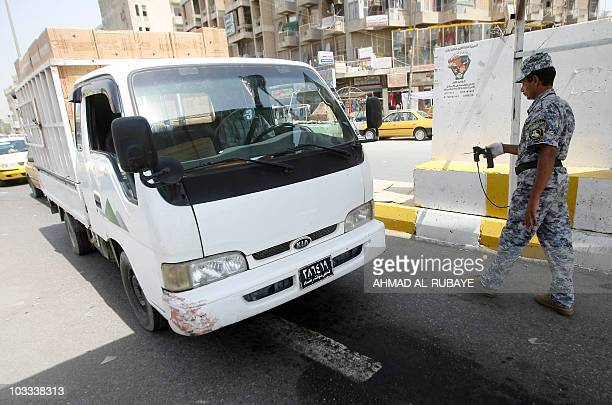 An Iraqi policeman stops a vehicle for a security check in Baghdad on August 11 2010 as Iraqi forces impose tight security measures with the start of...