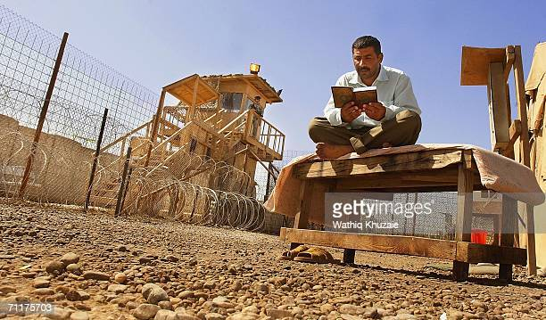 An Iraqi prisoner reads holy Quran before his release from Abu Ghraib prison on June 11 2006 west of Baghdad Iraq More than one hundred Iraqi...