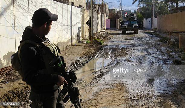 An Iraqi progovernment forces member looks towards a military vehicle during battles with Islamic State group jihadists as they try to secure all the...