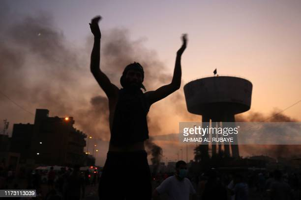TOPSHOT An Iraqi protester chants slogans during a demonstration against state corruption failing public services and unemployment at Tayaran square...