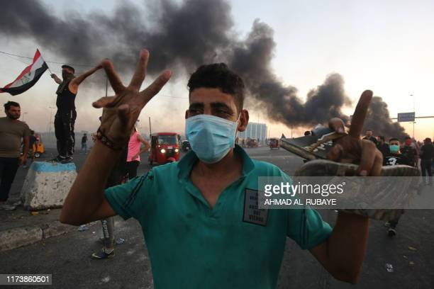 An Iraqi protester gestures during a demonstration against state corruption failing public services and unemployment in the Iraqi capital Baghdad on...