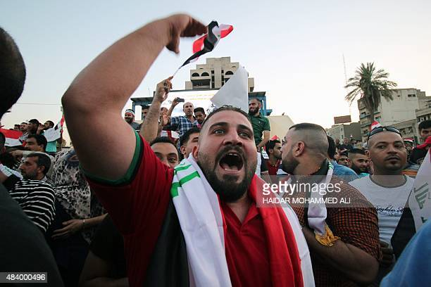An Iraqi protester shouts slogans during a demonstration to express support for Prime Minister Haider alAbadi's reform drive while calling on him to...