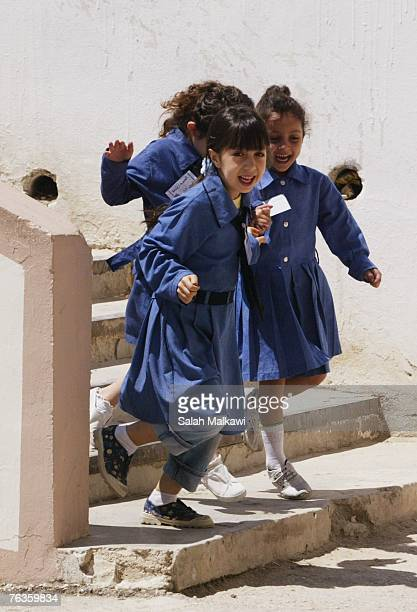 An Iraqi refugee student runs with other Jordanian students at the Shemeisani elementary school on August 28 2007 in Amman Jordan Ellen Sauerbery...