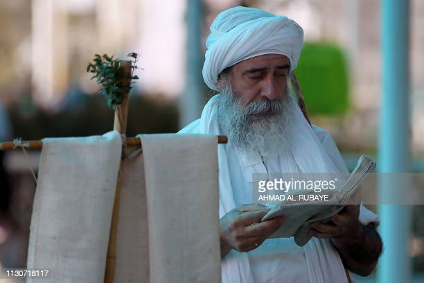 An Iraqi Sabean follower of a preChristian religion which considers the prophet Abraham as one of the founders of their faith reads a book in Baghdad...