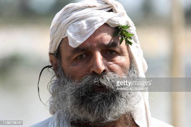 An Iraqi Sabean follower of a preChristian religion which considers the prophet Abraham as one of the founders of their faith looks on in Baghdad on...