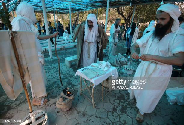 An Iraqi Sabean follower of a preChristian religion which considers the prophet Abraham as one of the founders of their faith attends a ceremony to...