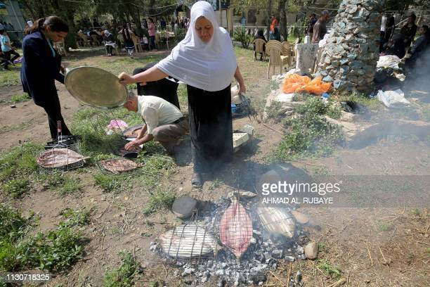 An Iraqi Sabean follower of a preChristian religion which considers the prophet Abraham as one of the founders of their faith cooks fish during a...
