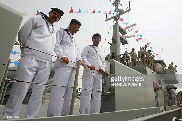 An Iraqi sailors stand on the deck of a navy vessel as Iraq inaugurated the first in a fleet of new USbuilt patrol boats on September 26 part of...