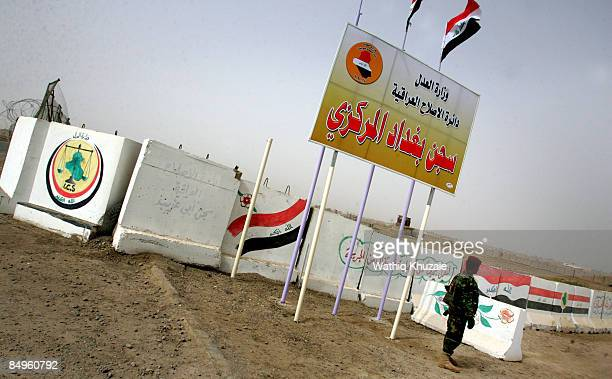 An Iraqi security guard patrols outside of the newly opened Baghdad Central Prison in Abu Ghraib on February 21 2009 in Baghdad Iraq The Iraqi...