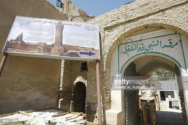 KRAUSS An Iraqi security guard stands at the entrance of a mosque at the Jewish shrine of Ezekiel the prophet who followed the Judeans into the...