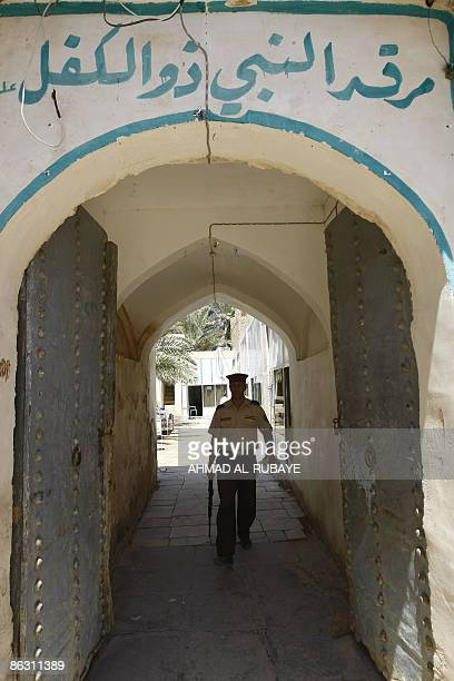 KRAUSS An Iraqi security guard walks through the entrance of a mosque at the Jewish shrine of Ezekiel the prophet who followed the Judeans into the...