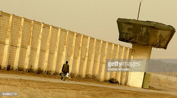 An Iraqi security officer patrols the grounds at the newly opened Baghdad Central Prison in Abu Ghraib on February 21 2009 in Baghdad Iraq The Iraqi...