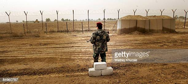 An Iraqi security officer stands guard outside the newly opened Baghdad Central Prison in Abu Ghraib on February 21 2009 in Baghdad Iraq The Iraqi...