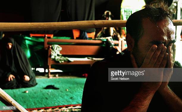 An Iraqi Shia cries outside the alKadamiya mosque in Baghdad during the March 3 2004 observance of three days of mourning across Iraq following...
