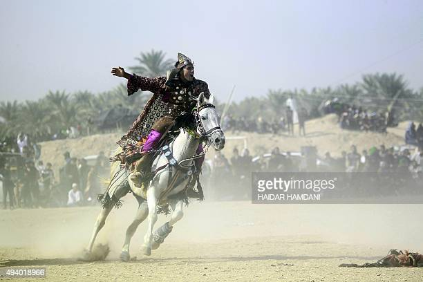 An Iraqi Shiite actor performs during the reenactment of the Battle of Karbala in the holy city of Najaf on October 24 as part of the Ashura...
