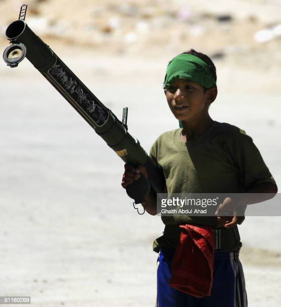 An Iraqi Shiite boy stands in the middle of a Najaf street waving a US rocket launcher during more fighting on August 11 2004 in the holy city of...