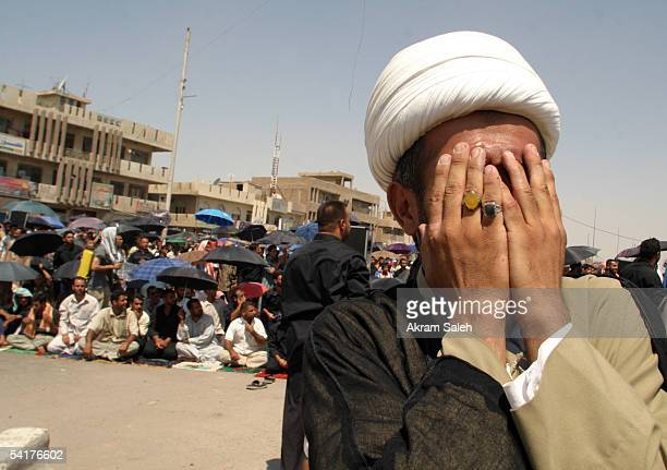 An Iraqi Shiite cleric cries as he attends a Friday prayer service September 2 2005 in the Sadr city neighborhood of Baghdad Iraq Iraqi Shiites...