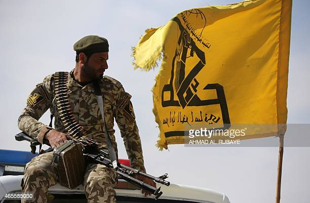 An Iraqi Shiite fighter and member of Iraq's Popular Mobilisation units supporting the government forces in the battle against the Islamic State sits...