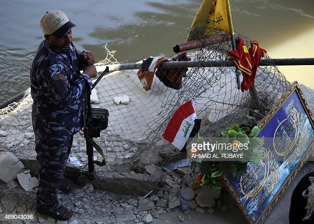 An Iraqi Shiite fighter from the popular mobilization units stands on the Tigris river waterfront in Tikrit on April 9 which is believed to be the...