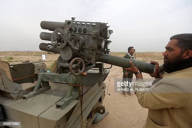 An Iraqi Shiite fighter of the governmentcontrolled Popular Mobilisation units prepares a rocket launcher before targeting Islamic state group's...