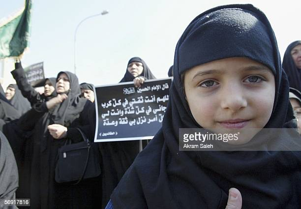 An Iraqi Shiite girl attends a protest against the bombing of a Shiite holy shrine on February 23 2006 in the Karradah district in Baghdad Iraq...