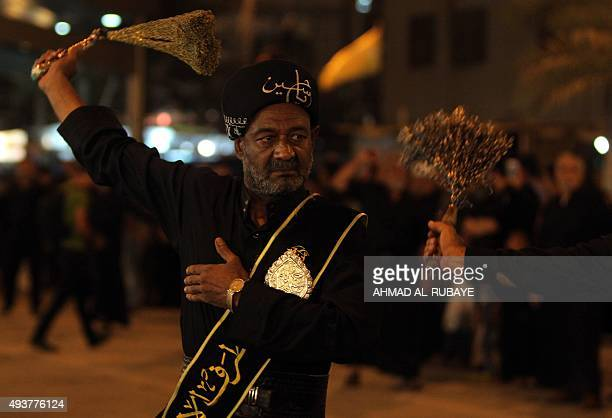 An Iraqi Shiite man beats himself with chains as part of a selfflagellation ritual during a parade in preparation for the peak of the mourning period...