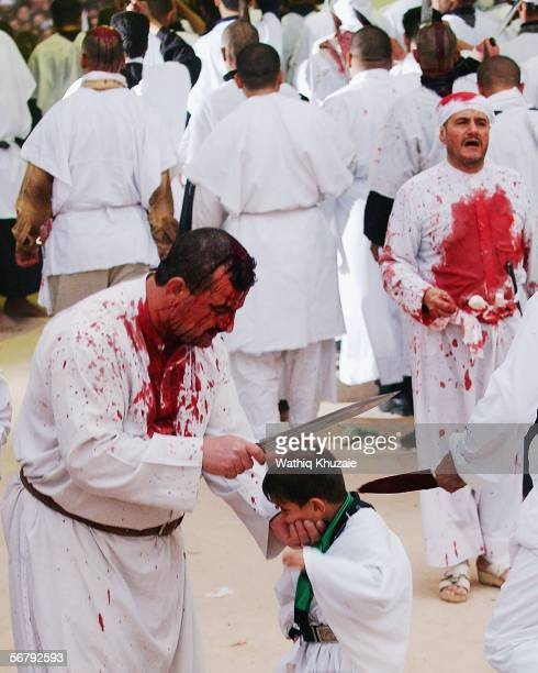 An Iraqi Shiite man flagellates a Shiite child as they mark the anniversary of the death of Imam Hussein in the early hours of February 9 2006 in...