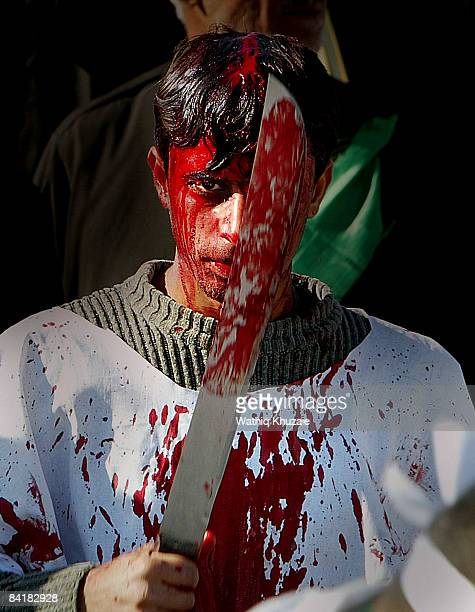 An Iraqi Shiite man flagellates himself on the eve of Ashura the death anniversary of Imam Hussein on January 6 2009 in Baghdad Iraq Iraqi Shiites...