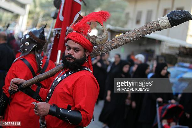 An Iraqi Shiite man looks on during the reenactment of the Battle of Karbala in preparation for the peak of the mourning period of Ashura in...